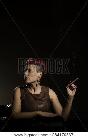 Vertical Shot Of Modern Woman With Fuchsia Hair Holding A Cigar