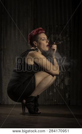 Sultry Woman With Fuchsia Hair Smoking A Cigar