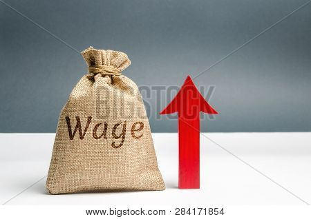 Bag With Money And Word Wage And Up Arrow. Increase Of Salary. Wage Rates. Career Growth. Increase P