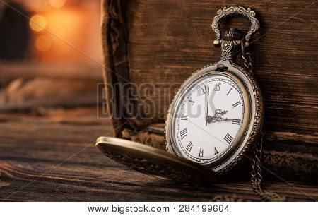 Old Pocket Watch On The Wooden Table With Copy Space