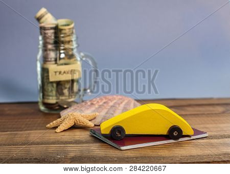 Saving money for travel in glass jar