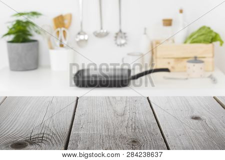 Rough Wooden Planks In Front Of Defocused Kitchen Cooking Place