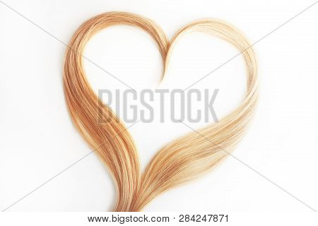 Strand Of Blond Hair Isolated On White. Curls Of Hair In The Shape Of A Heart, Health And Hair Care