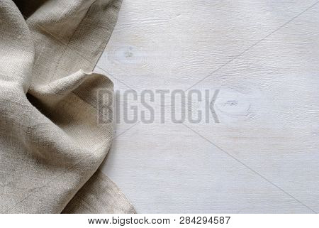 Folded Gathered Border Of A Natural Linen Fabric Showing The Detail Of The Weave Over Textured Paint