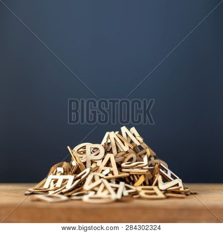An image of a pile of wooden letters background