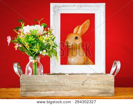 An image of an artificially bunch of flowers easter bunny holiday decoration background