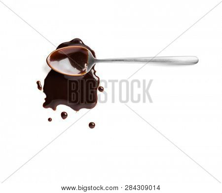 Spoon with liquid chocolate on white background, top view, including clipping path