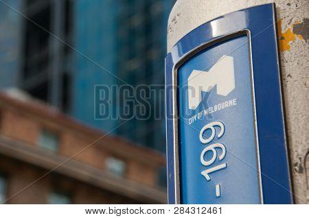 Melbourne, Australia - July 26, 2018: Logo For City Of Melbourne With 199 Number On Light Pole