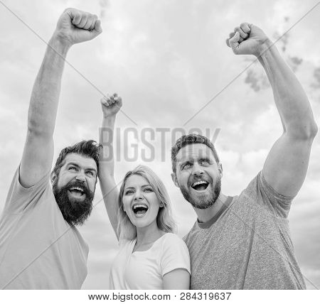 Woman And Men Look Confident Successful Sky Background. Behaviors Of Cohesive Team. Celebrate Succes