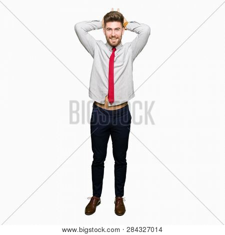 Young handsome business man Posing funny and crazy with fingers on head as bunny ears, smiling cheerful