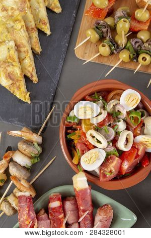 Top View Of Spanish Tapas Snacks With Olives, Anchovies And Peppers