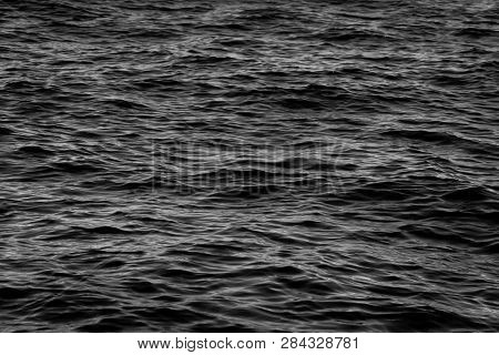 Dark Black And White Sea Water With Calm Waves  Texture Or Background