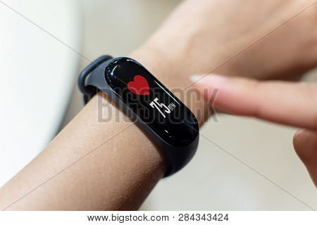 Close Up Image Hand Of Male Using Smart Watch With Health App Checking Measure Heart Rate At Normal