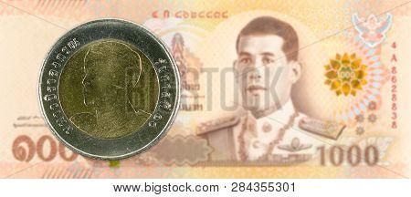 10 New Thai Baht Coin Against 1000 New Thai Baht Banknote