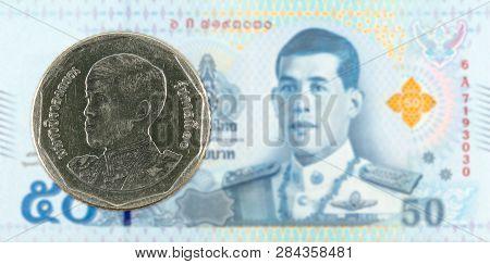 5 New Thai Baht Coin Against 50 New Thai Baht Banknote