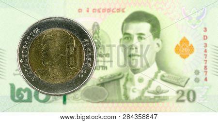10 New Thai Baht Coin Against 20 New Thai Baht Banknote
