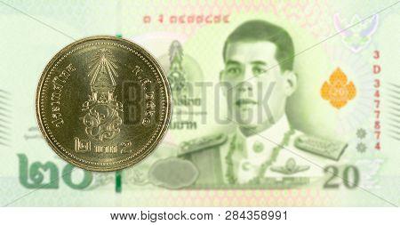 2 New Thai Baht Coin Against 20 New Thai Baht Banknote