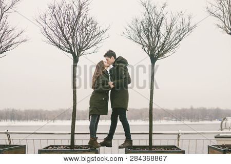 A Heterosexual Couple Young People In Love Students A Man And A Caucasian Woman. In Winter, In The C