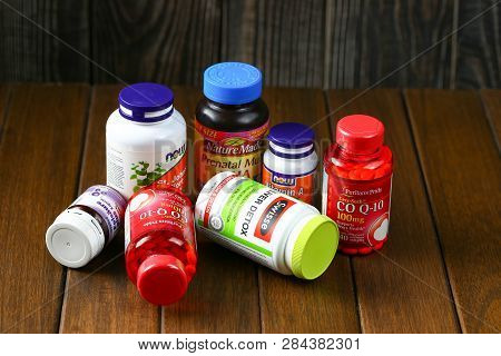 Jinan, China-january 12 2019:color Bottle For Supplement Product Isolated On Brown Wooden Table Back