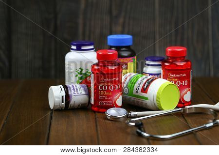 Jinan, China-january 12 2019:color Bottle For Supplement Product And Stethoscope Isolated On Brown W