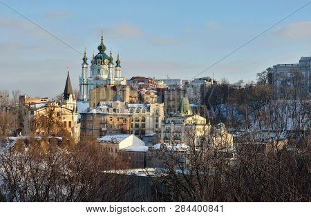 Kyiv Skyline And Saint Andrew's Church Located At The Top Of Andriyivskyy Descent In Kiev ,view From