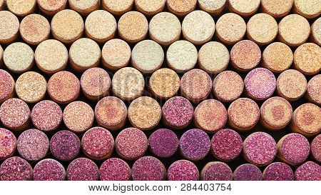 Background Of Used Wine Corks.  Wine Corks From White And Red Wine Arranged In Rows By Color. Wine S