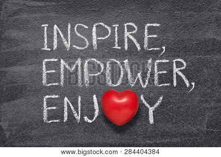 Inspire, Empower, Enjoy Words Written On Chalkboard With Red Heart Symbol Instead Of O