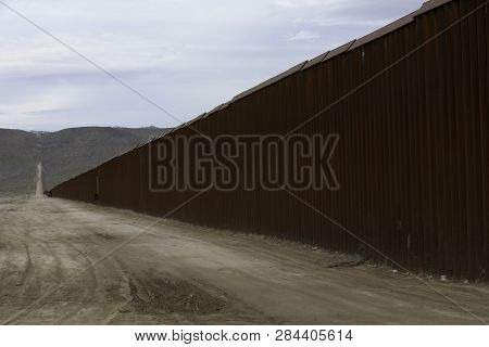 Wall  Seperating The United States From Mexico At Jacumba In California