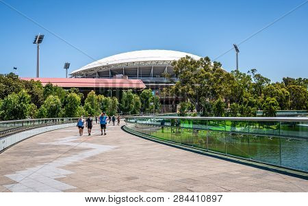 31st December 2018, Adelaide South Australia : People On Riverbank Curved Footbridge Over Torrens Ri