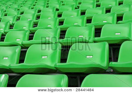 Green Empty Plastic Seats At Stadium