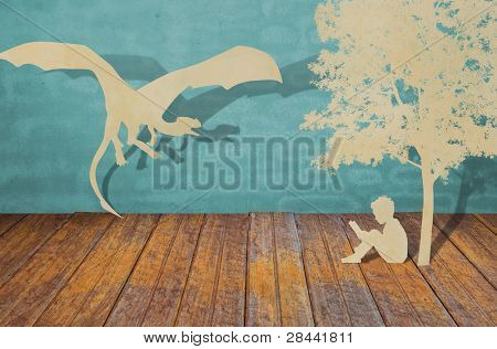 Paper cut of children read a book under tree and dragon