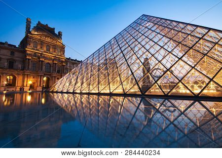 Paris, France - July 6: The Louvre Pyramid At Dusk During The Michelangelo Pistoletto Exhibition On
