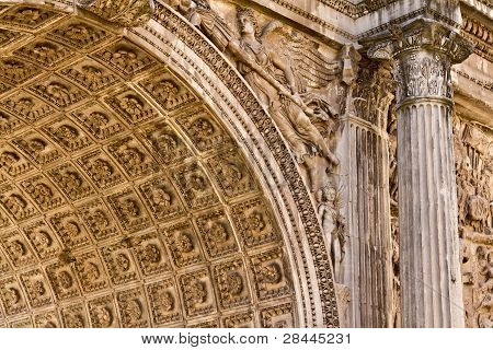 An ancient Roman arch with intricate details