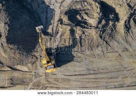 Aerial View Of Excavator And Construction Equipment. Machinery And Mine Equipment From Above. Top Vi