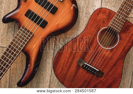 What To Choose Top View On Two Cool Musical Instruments: Acoustic And Electric Guitars Are Lying On