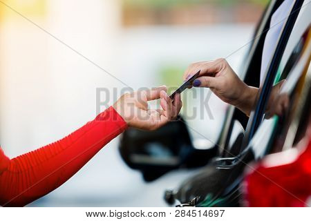 Selective Focus To Woman Driver Pay Credit Card