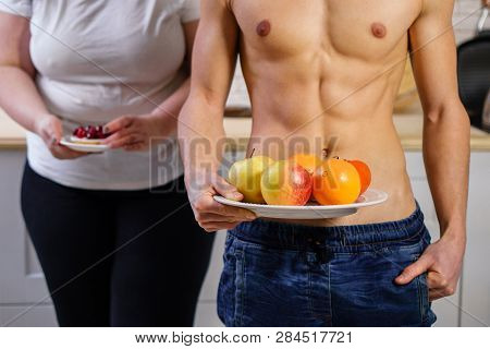 weight loss, motivation, fitness, diet, lifestyle, choice. fit muscle man with healthy food and overweight woman with sugary cake poster