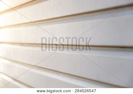 Part Of The Wall Of The House Covered With Siding.