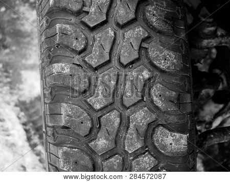 Terrain Tyre Close Up Shot On Offroad Vehicle At Roadside.
