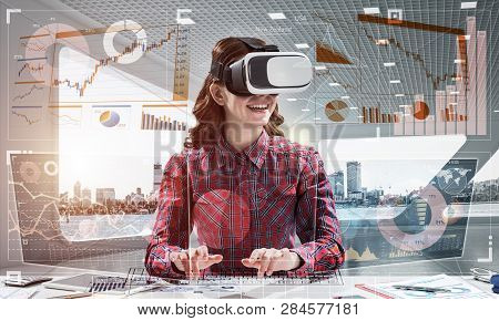 Portrait Of Beautiful And Young Woman In Red Checkered Shirt Using Vr Goggles And Interracting With