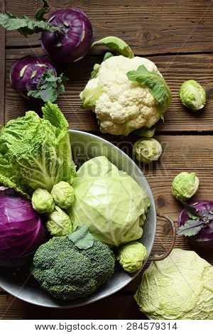 Different Varieties Of Cabbage. Organic Fresh Vegetables - Cauliflower, Kohlrabi, Broccoli, White An
