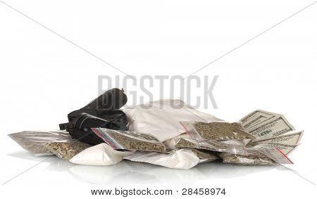 ?ocaine and marijuana in packet with gun isolated on white