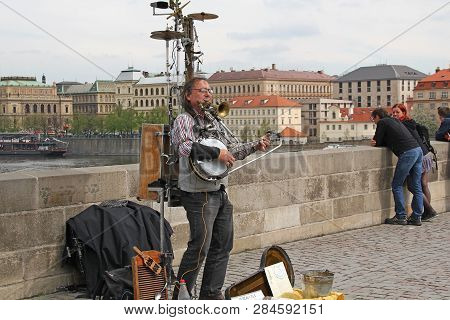 Prague, Czech - April 24, 2012: An Unidentified Street Musician Gives Concerts In Front Of Passersby