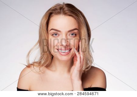 Adult Beautiful Blond Woman With Her Hand Near Face And White Veneers On The Teeth. Beauty Woman Wit