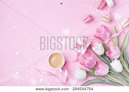 Morning Cup Of Coffee, Cake Macaron, Gift Box And Spring Tulip Flowers On Pink Background. Beautiful