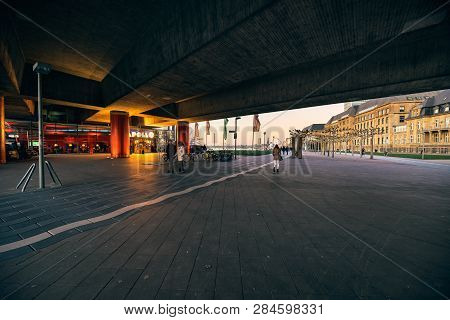 Duesseldorf, Germany - January 20, 2019: Unidentified Pedestrants Walk By The Apollo Theater At Rive