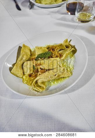 Homemade Scarpinocc Cheese And Sage Fillings On A Table Of A Trattoria. Fresh Stuffed Pasta Typical