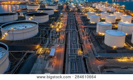 Gas Storage Tank, Oil Storage Tank, Aerial View Oil And Gas Storage At Night.