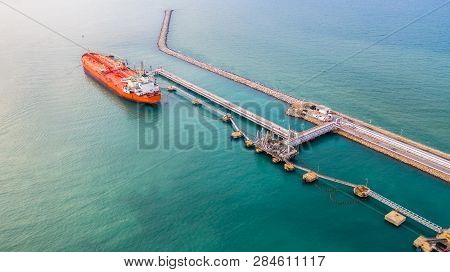 Fuel Tanker Ship Loading In Port View From Above, Tanker Ship Logistic Import Export Business And Tr