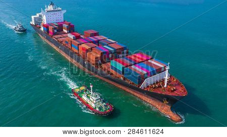 Container Ship Arriving In Port, Tug Boat And Container Ship Going To Deep Sea Port, Logistic Busine